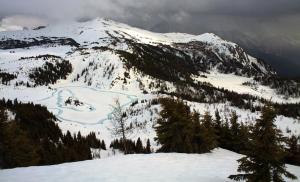 Signs of spring can be seen this week on the Great Divide. The webcam on Standish Peak at Sunshine Village looks down on Rock Isle Lake, where hints of blue water around the shoreline and islet indicate melting ice. But it's still a long wait for hiking season in the Sunshine Meadows!