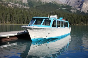 Covered tour boats make the trip on Maligne Lake enjoyable in all weather conditions.