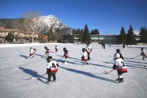 Local children playing hockey on the downtown rink on Banff Avenue.