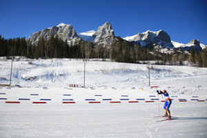 A racer comes up to the finish line at a World Cup event hosted by the Canmore Nordic Centre.