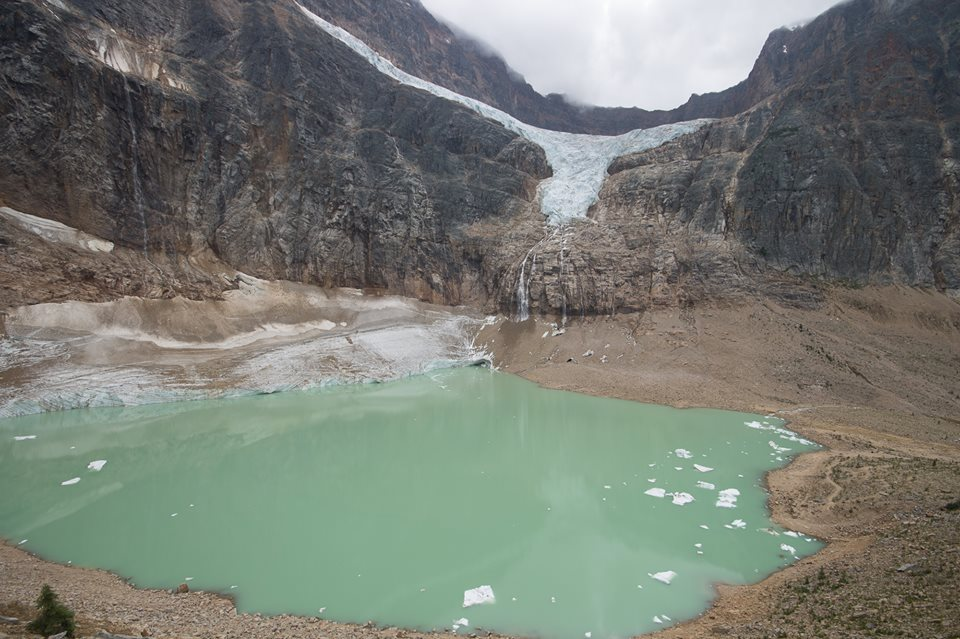 Cavell Pond (left) is shown just prior to overflow on the night of August 15. The resulting outwash that created a new channel below the pond (right). Photos by Parks Canada/Rogier Gruys.
